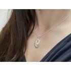 Kettenanhänger oval aus 925 Silber mit klaren Kristallsteinen besetzt